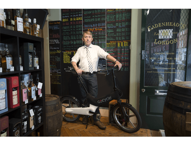 Stephen Worrel and his Gocycle in his Whiskey shop in London.