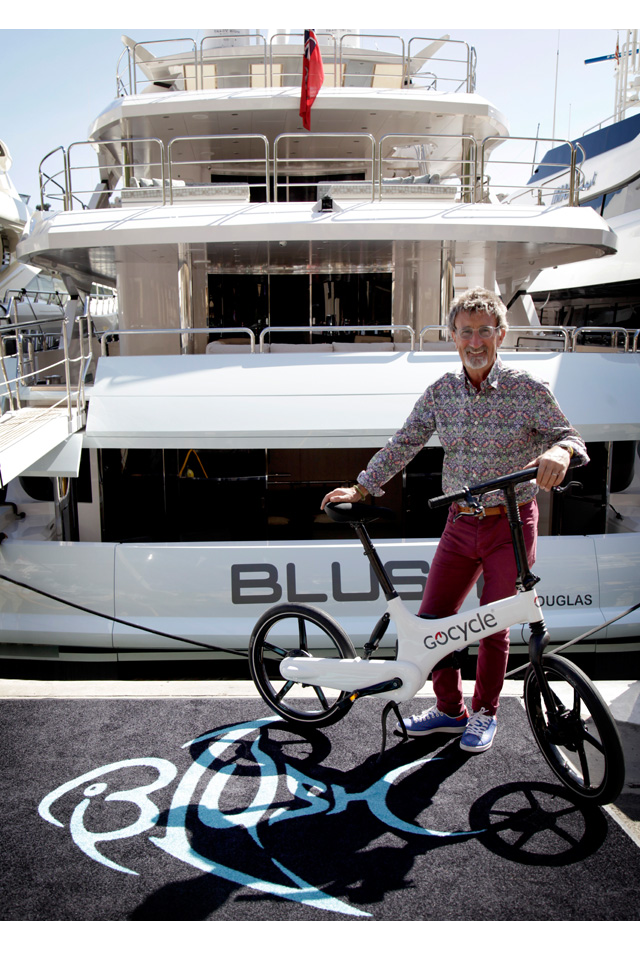 Eddie Jordan with his Gocycle on his super yacht Blush.