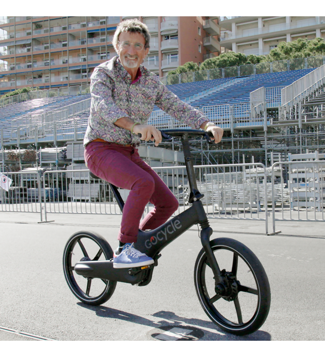 Eddie Jordan riding his Gocycle.